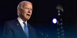 Biden says challenging for U.S. to reach herd immunity by summer's end
