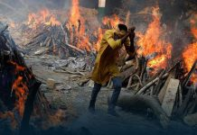 Delhi crematoriums forced to build makeshift funeral pyres